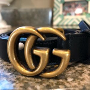 Gucci leather belt with double G buckle.